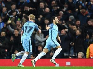 Ilkay Gundogan (r) scored two goals and Kevin de Bruyne one in the victory over Barcelona.