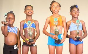 In the tiny tots girls six to eight bodybuilding, Sariyah Holder (left) of Belmont Primary came fourth, Tianna Murray of Bay Primary (right) was third, Tiara Padmore of George Lamming, second, and the winner Ashari Brathwaite of Wilkie Cumberbatch.