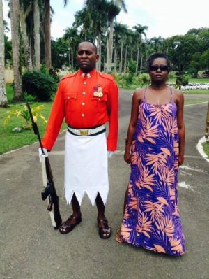 Lynn standing with a Fijian guard at the President's  residence.