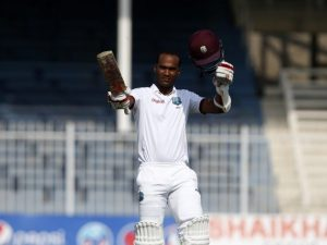 Kraigg Brathwaite salutes his teammates on reaching his fifth Test century.