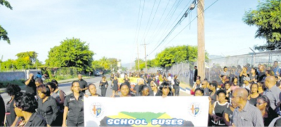 A banner appealing for school buses is displayed at last Monday's silent protest to bring attention to violence against schoolchildren staged at Jamaica College (JC) in the aftermath of the brutal killing on October 26 of 14-year-old JC student Nicholas Francis by a thief who demanded his cellphone on a public passenger bus.