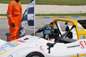 Suleman Esuf giving the thumbs-up after claiming the chequered flag.