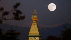 The supermoon is seen here above the Boudhanath stupa in Kathmandu, Nepal.