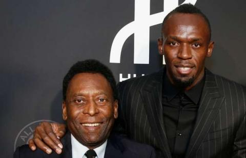 Usain Bolt (r) and Pele.