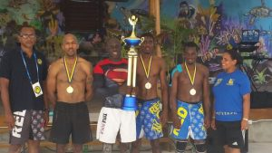 (l-r) President of the Barbados Wrestling Association Rollins Alleyne, Francois Jones, Renaldo Stuart, Kobe Bowen, Shackeem Mascoll and coach Yaima Payne.
