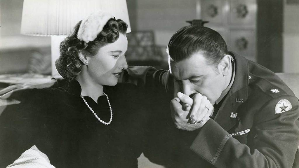 George Brent tries to seduce a shy Barbara Stanwyck in a scene of My Reputation (1946), ranked number 14 in Barbara Stanwyck best movies