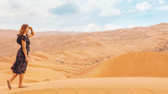 impact of trauma as woman walks in the omani desert facing an uncertain future