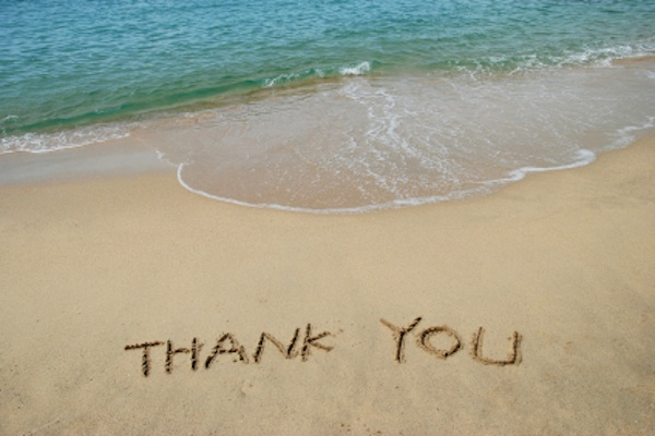 thank you written on the beach