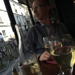 Shane at Paris cafe with wine