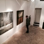 The artist, Shane Robinson, gazing at the work of painter, Yan Marczewski