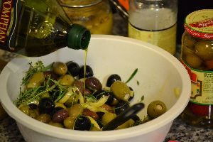 Adding the olive oil to the ingredients_small