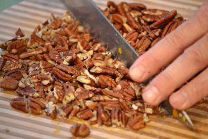 chopping the already roasted walnuts_small