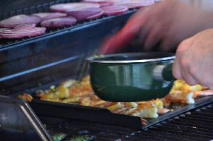 placing the butter on the shrimp on the grill_small