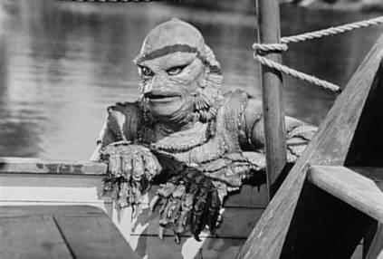 Creature climbing onto boat