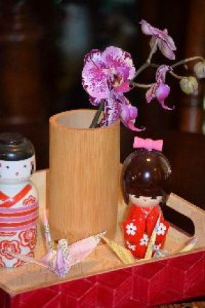Orchids_in_bamboo_cup