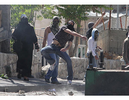 "Some 20 masked Arabs throw stones riot in east Jerusalem neighborhood as 30 Israelis marched in the east Jerusalem neighborhood of Shiloah/Silwan. Several of the neighborhood's Arab residents stood on the rooftops, some chanting, ""Allahu Akbar""  and ""police, this is our Palestinian village""."