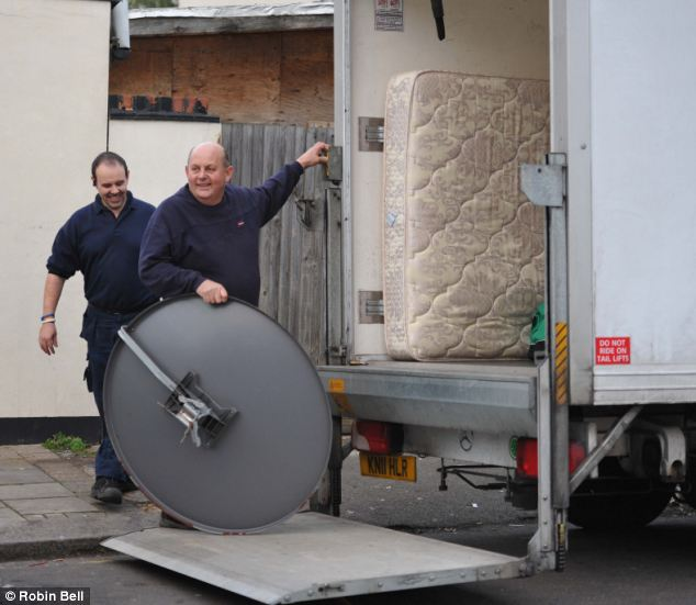 Furniture movers (paid for by taxpayers) unload Qatad'a satellite dish