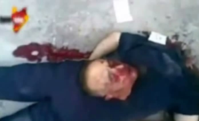 Recent photo of another man beheaded by a child in Syria