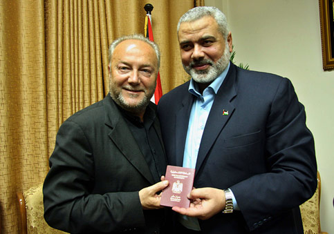 British MP and member of the Viva Palestina flotilla, George Galloway, receives a Palestinian passport from HAMAS Prime Minister Ismail Haniyeh in Gaza City, March 2009.