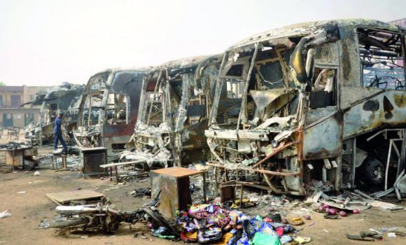 The charred remains of buses after Monday's explosions at a bus park in Sabon Gari in Kano, Nigeria,