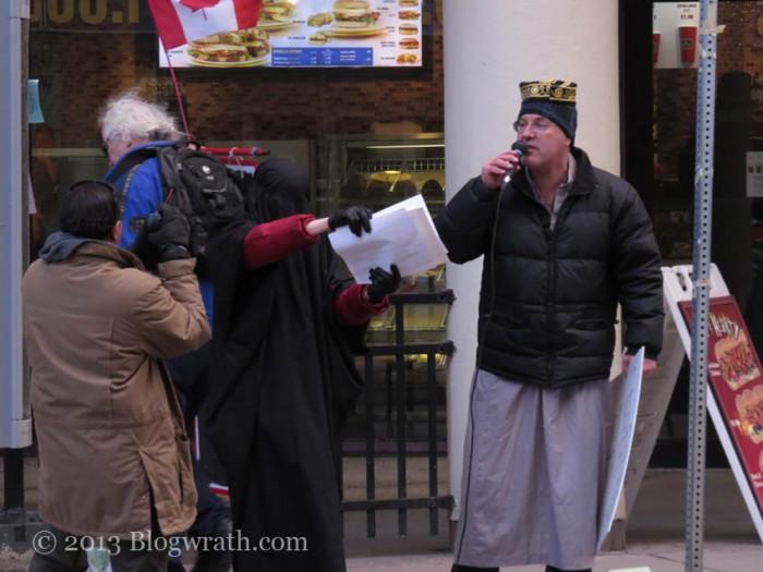 Mock Imam giving mock sermon