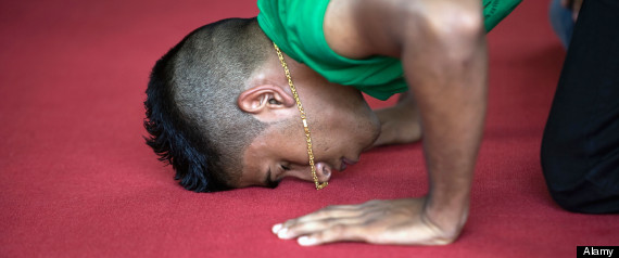 Suriname, Paramaribo, Friday prayers at main mosque in Keizerstraat in the historic inner city. Portrait.