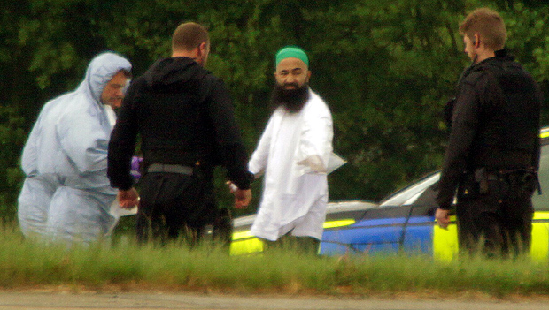 MUSLIM Suspect surrounded by police outside plane