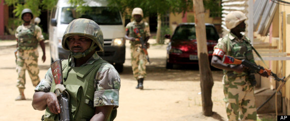 Nigerian soldiers stand guard at the offices of the state-run Nigerian Television Authority in Maiduguri, Nigeria. Boko Haram, the radical group that once attacked only government institutions and security forces, is increasingly targeting civilians