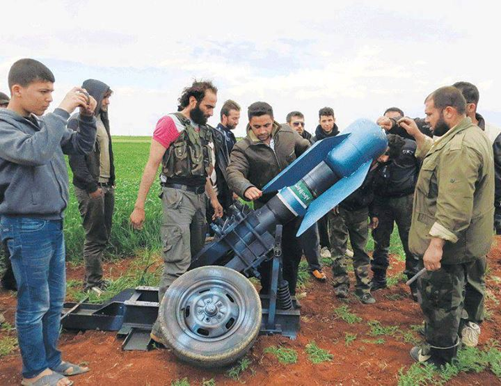 FSA rebel jihadists loading what appears to be a chemical weapon