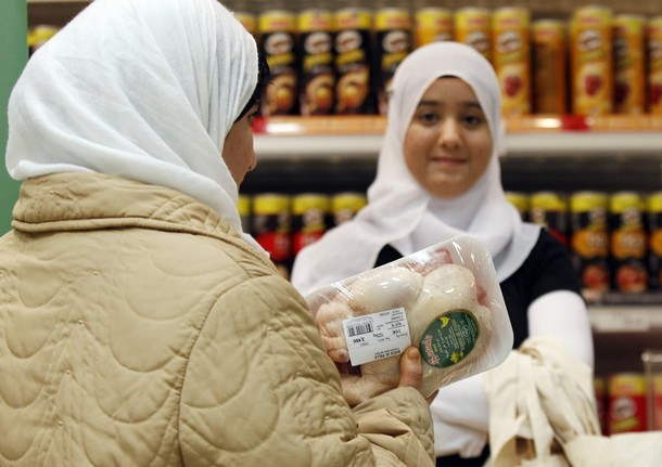 Moroccan women buy halal food in a Coop supermarket chain in Rome