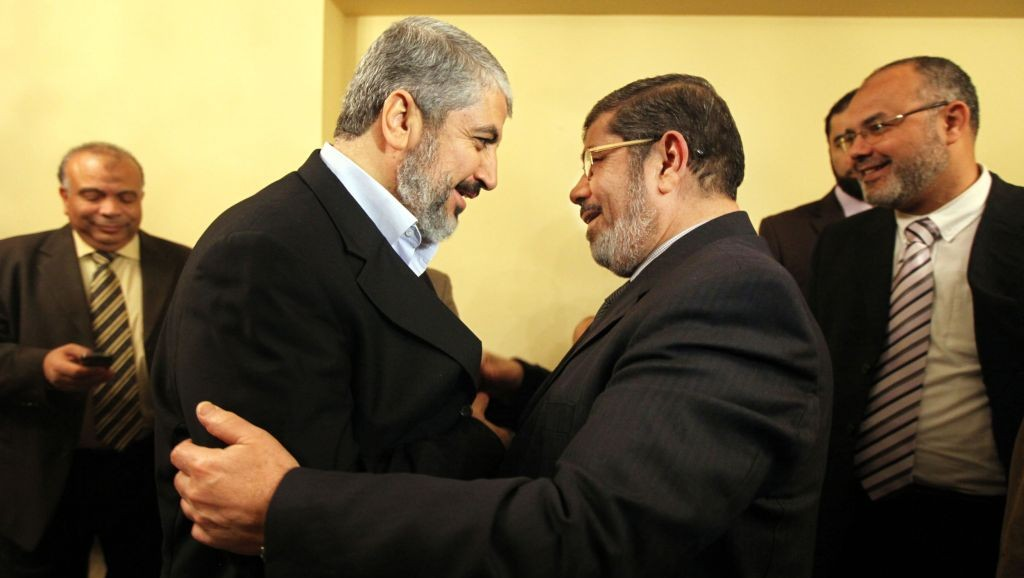 Hamas leader Khaled Mashal, left, congratulates Mohammed Morsi, the Muslim Brotherhood party's leader for winning the biggest number of seats in parliamentary elections in Cairo, January 21, 2012. And we know what happened to Morsi in June of 2013!