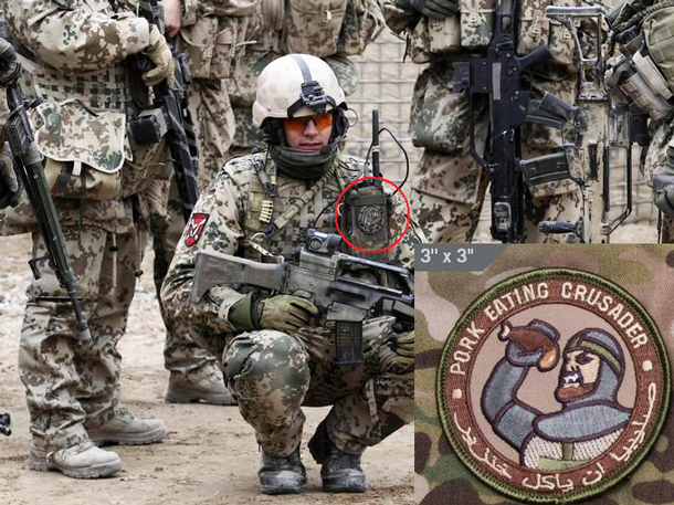 Soldier, Afghanistan. Part of the NATO ISAF (International Security Assistance Force) forces. Note that the patch is in Arabic as well as English so that the meaning isn't obscured.