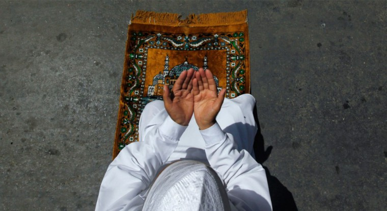 A-man-raises-his-hands-in-prayer-while-sitting-on-a-prayer-mat-outside-a-mosque-on-the-first-Friday-of-Ramadan-in-Srinagar-on-August-5-2011.-ReutersFayaz-Kabli-960x525
