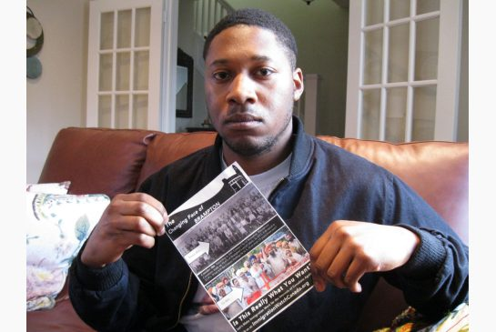 NICHOLAS KEUNG / TORONTO STAR Order this photo Brampton resident Jamal Jones holds an anti-immigration flyer that was delivered to his home this week. Jones says he finds the flyer offensive and racist.