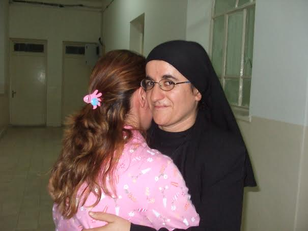 It was Sister Hatune Dogan, Rescue Christians' Middle East contact, who payed the ransom and saw to it that the required surgery be done. Here is a picture of Sister Hatune Dogan with the girl who was slashed by the blade: