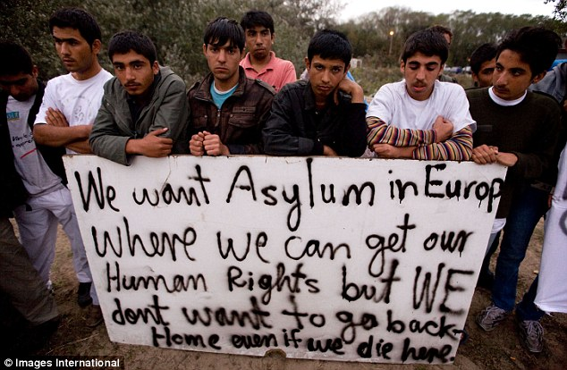 Faces of defiance and a despairing message as migrants prepare for the French onslaught on the Jungle