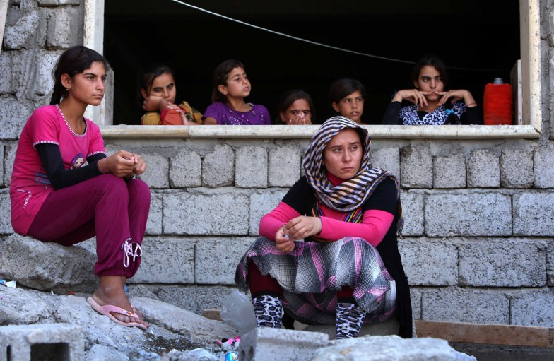 Yazidi women who fled the violence in the northern Iraqi town of Sinjar sit Tuesday at a school where they are taking shelter, in the city of Dohuk in Iraq's semi-autonomous Kurdistan region.