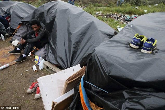 1409941266575_wps_8_An_Erythrean_migrant_sits