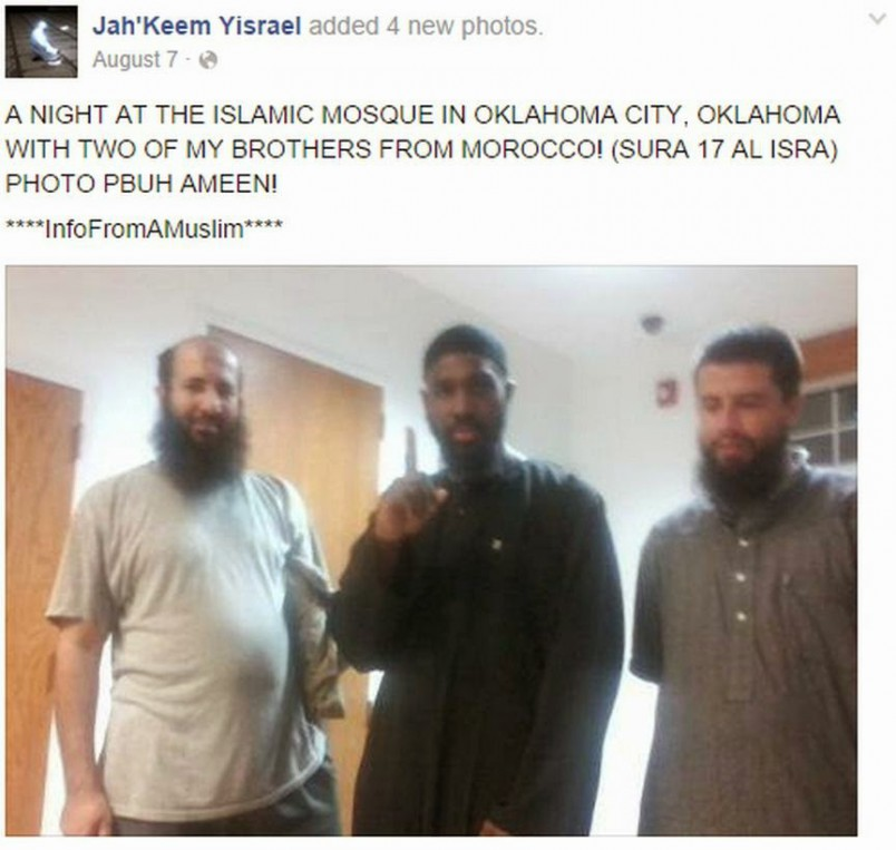 Note the Beheader giving the one-finger ISIS salute