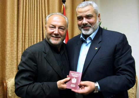 George Galloway accepting his honorary Hamas passport from Hamas leader Haniyeh