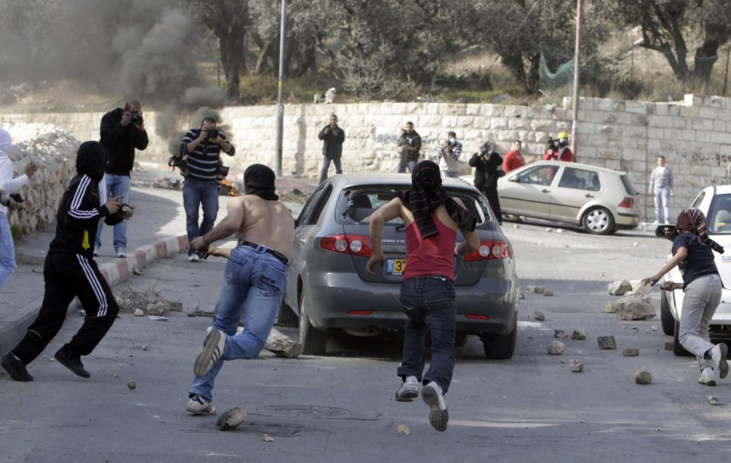 Image result for muslims throw stones at car jerusalem