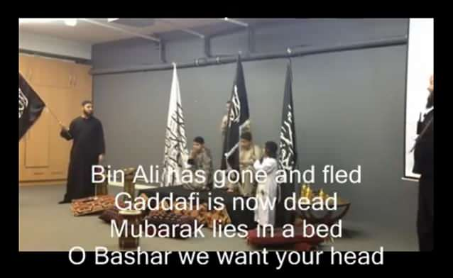 A chilling new video unearthed by 7News reveals young children calling an end to Australian democracy, for American President Barack Obama to 'go to hell' and for Syrian President Bashar al-Assad to be beheaded.