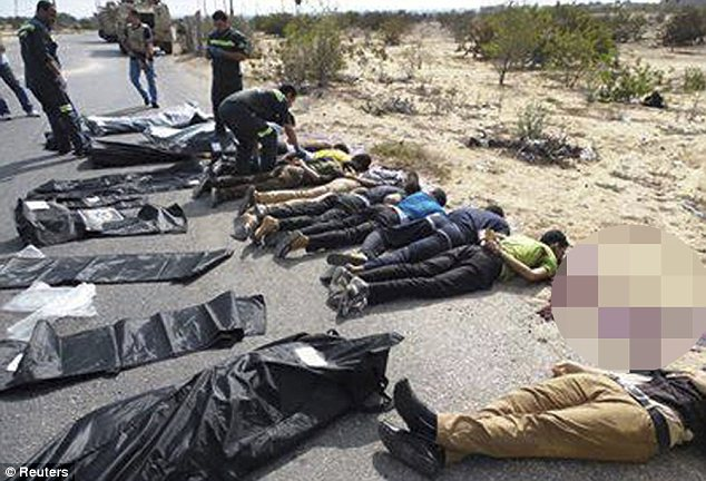 Slaughter: The scene in Sinai following the killing of 31 police officers by militants near Egypt's border with Gaza