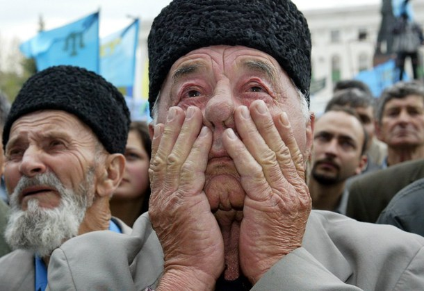 Photo shows a Crimean Tatar man crying during a mass rally held on the 60th anniversary of the deportation of Muslim Tatars by Stalin from Crimea. Why ever did they let them back in?
