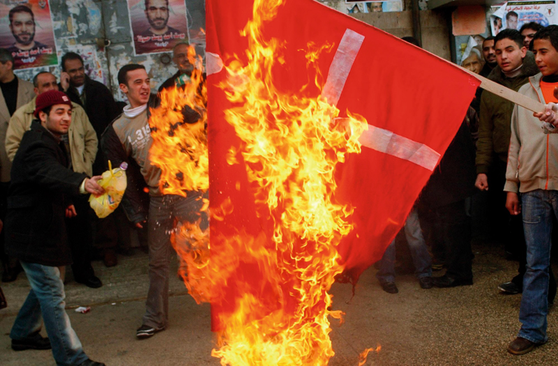 Muslims burning the Danish flag