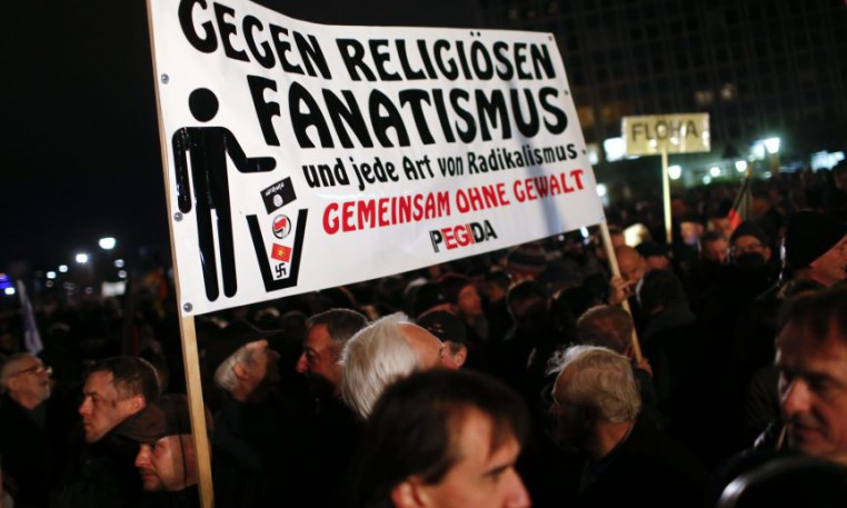 Participants hold a banner during a demonstration called by anti-immigration group PEGIDA in Dresden