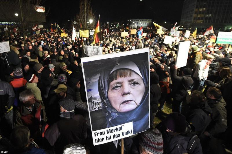 Chancellor Angela Merkel in a Muslim headbag