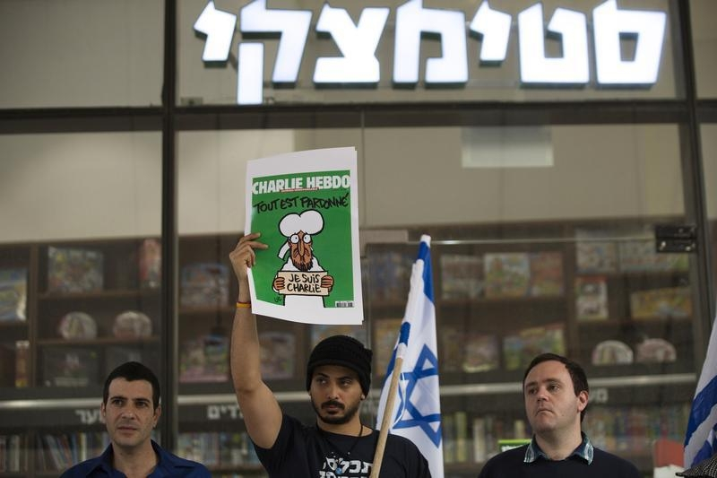 Israeli protesters demonstrate outside a Steimatzky bookstore in Tel Aviv, against what they say is the surrender of the bookstore chain to extremist threats