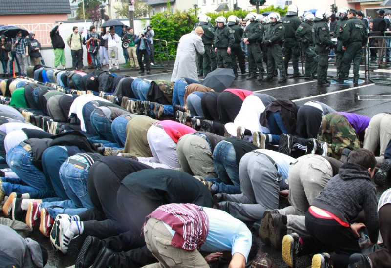 Muslims lifting their asses to Allah in the streets of Bonn, Germany