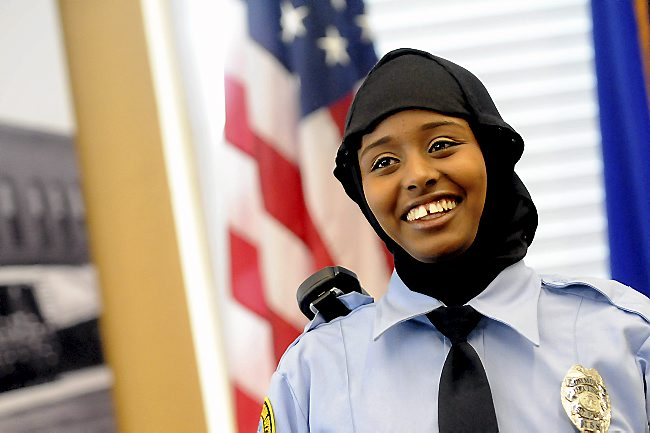 Kadra Mohamed is the first Somali Muslim woman to join the St. Paul Police Department, a move made possible by the department's announcement that it has approved an option for employees to wear a police-issued headbag.